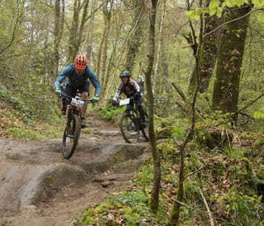 Two people practicing mountain bike