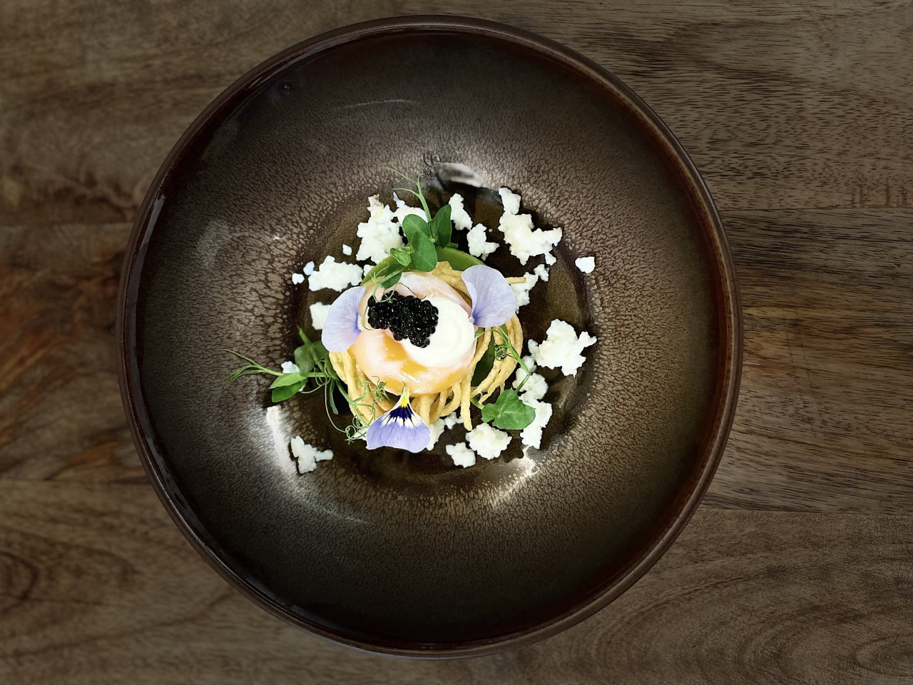 Wood colored plate with food on it